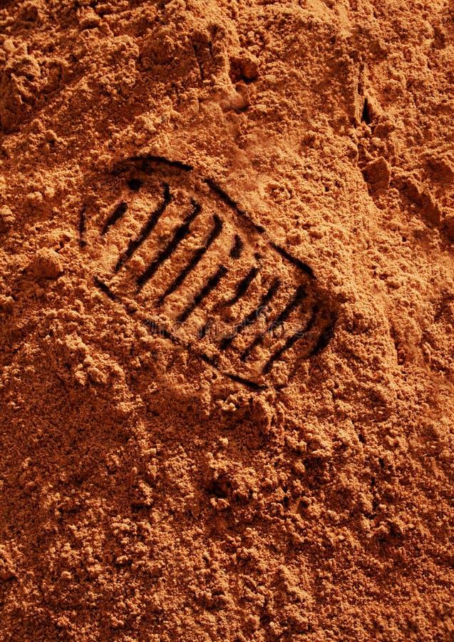 Astronautische voetafdruk op rood marszand stock afbeeldingen