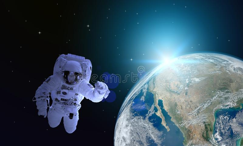 The astronauts float in space. The path to cutting this extra image is decorated by NASA.The astronauts float in space. The path stock images