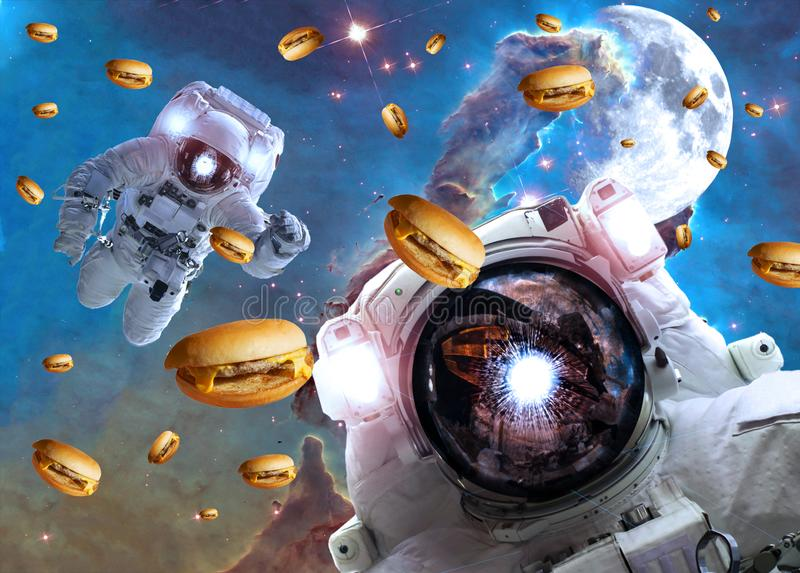 Astronauts in outer space with cheseburgers. On the  pillar of creation and the Moon on the background. Elements of this image furnished by NASA. Suitable for stock image