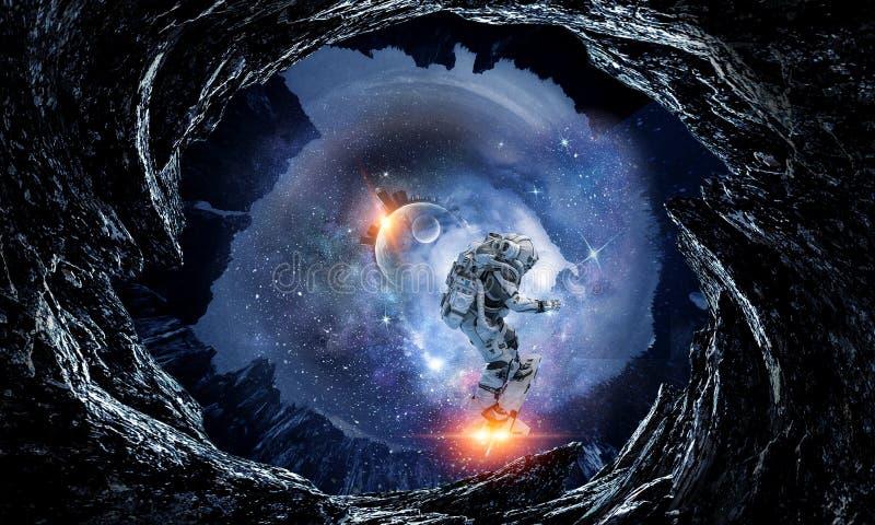 Astronautyczna dziura i astronauta Mieszani środki zdjęcie royalty free