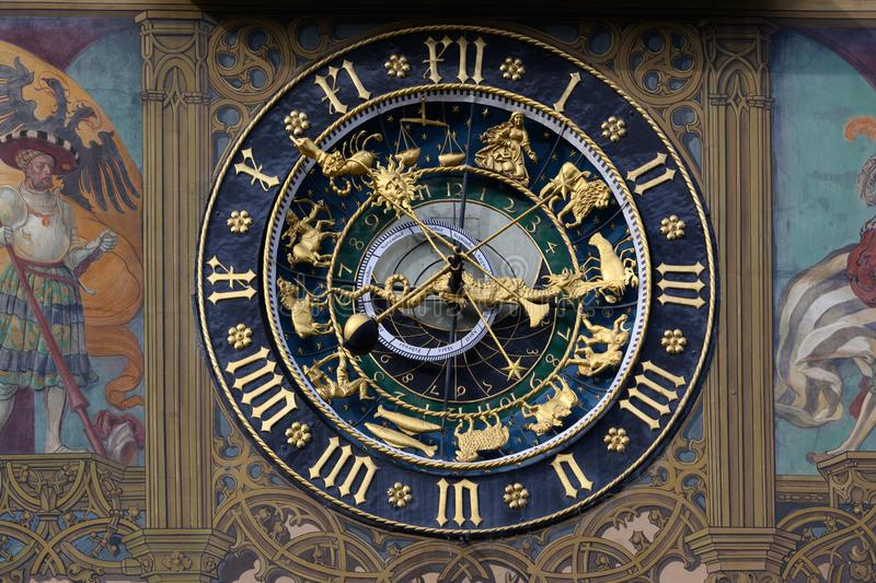 Ornamental astrological clock in historic city of Ulm on Romantic Street, Baden-Wuerttemberg, Germany. Astronomical clock covered in detailed murals on Twon stock image