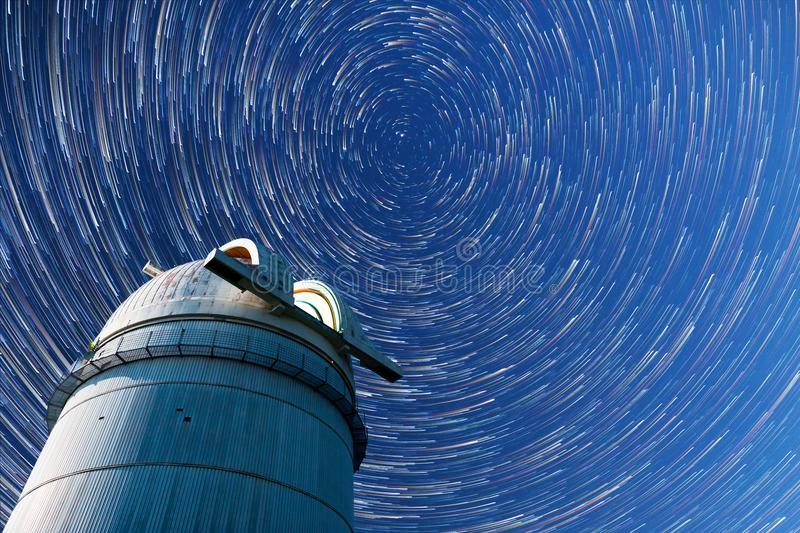 Astronomical Observatory night sky stars. Timelapse in comet mod royalty free stock photography