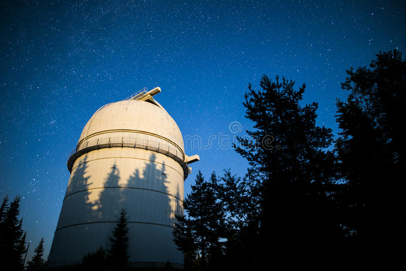 Astronomical Observatory under the night sky stars. Vignette stock photography