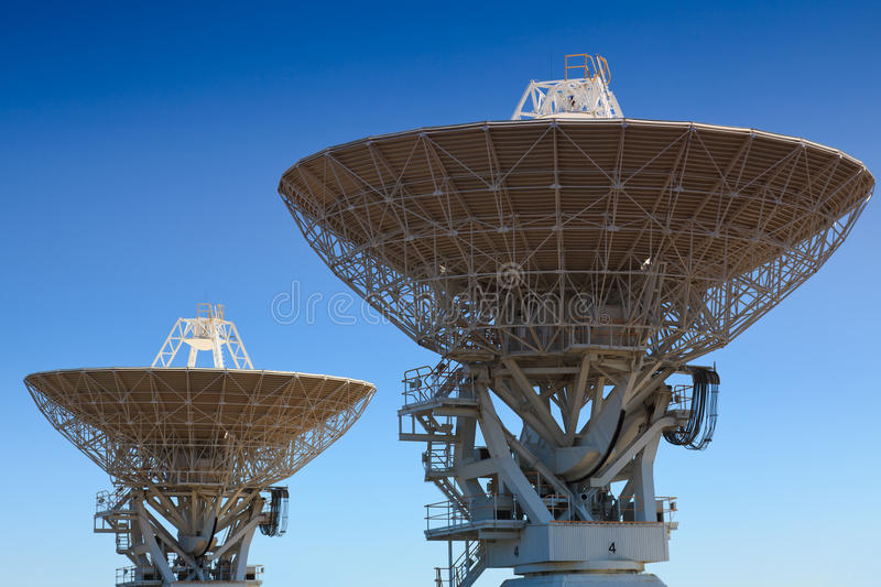 Astronomy 2 antenna. Close-up view of top parts of two antennas of astronomy radio equipment for space research via big science dishes royalty free stock photo