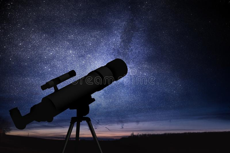 Astronomy and stars observing concept. Silhouette of telescope and starry night sky in background.  stock images