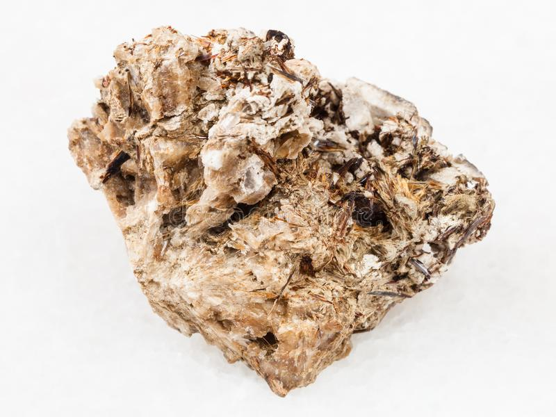 Astrophyllite crystals in Natrolite stone on white royalty free stock image