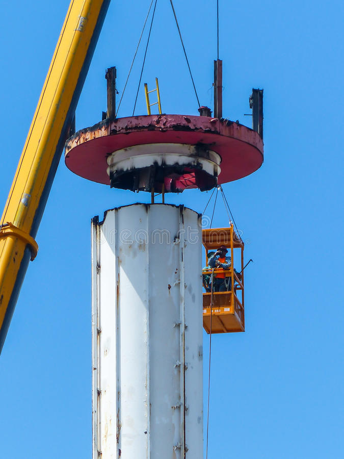 Astrotower. Removing the last part of the Astrotower's top in Luna Park on July 4, 2013 due to unsafe conditions. The Astrotower was built in 1964 as part of the stock image