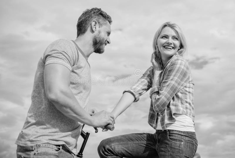 Asual acquaintance concept. Man with beard and shy blonde girl on first date. Couple just meet to hang out together. Woman feels shy in company with attractive royalty free stock photos