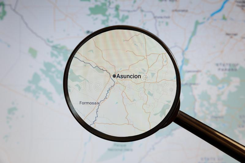Asuncion, Paraguay. Political map. The city on the monitor screen through a magnifying glass stock image