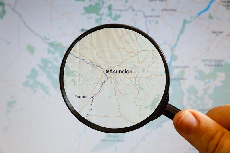 Asuncion, Paraguay. Political map. The city on the monitor screen through a magnifying glass in hand stock photos