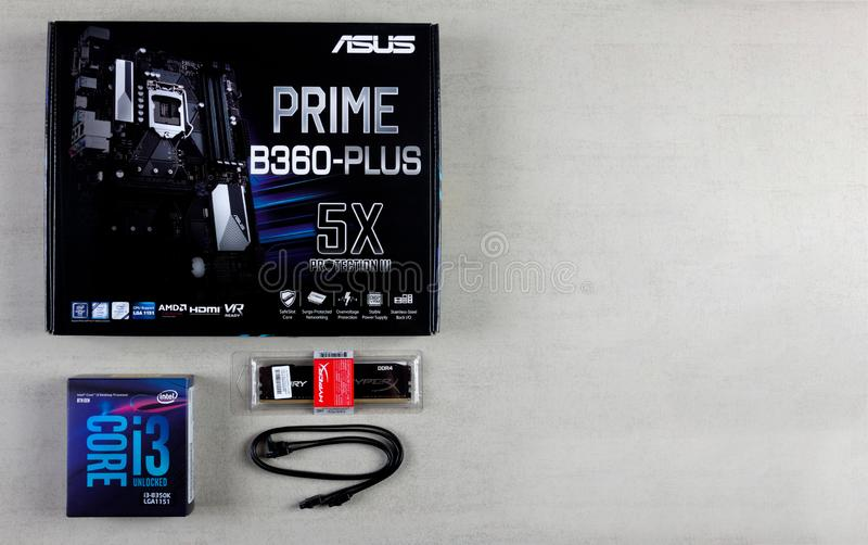 Asus motherboard in box, processor intel I3, RAM Kingston Fury Hyper 16 GB and cable for connecting devices SATA 6Gbs on a gray ba royalty free stock image