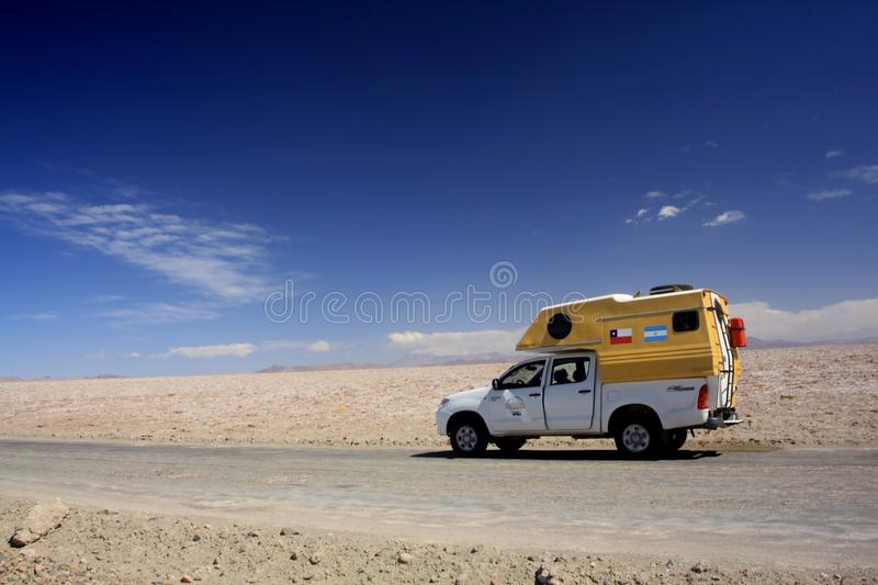 ATACAMA DESERT, CHILE - DECEMBER 19. 2011: 4 wheel camperlost in endless barren landscape stock images