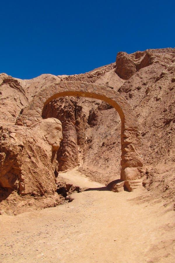 Atacama desert stone arc. Dry desert in Atacama, Chile. Arid flat land and mountains in Moon valley stock photography