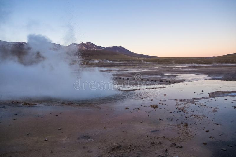 Atacama geysers del Tatio emitting steam in the early morning royalty free stock photos