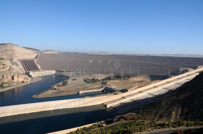 Atatürk Dam at euphrates river in south eastern Turkey. Atatürk barrage is a zoned rock-fill dam with a central core on the Euphrates River on the border royalty free stock photos
