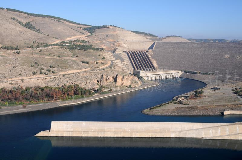 Atatürk Dam at euphrates river in south eastern Turkey. Atatürk barrage is a zoned rock-fill dam with a central core on the Euphrates River on the border stock image
