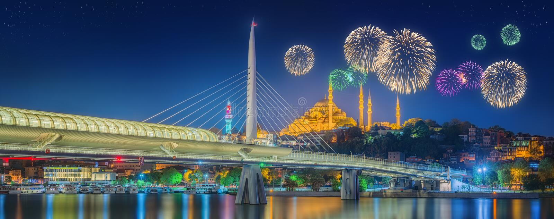Ataturk bridge, metro bridge and beautiful fireworks, Istanbul royalty free stock images