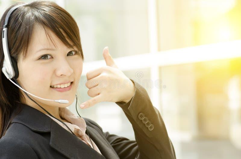 Atención al cliente femenina asiática foto de archivo