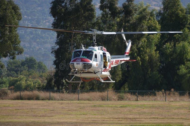 Aterrissagem com helicóptero contra incêndio no American Heroes Air Show fotografia de stock royalty free