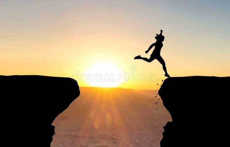 Aterrissagem da mulher após o salto sobre o abismo imagem de stock