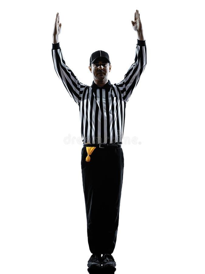 A aterrissagem do árbitro do futebol americano gesticula silhuetas foto de stock