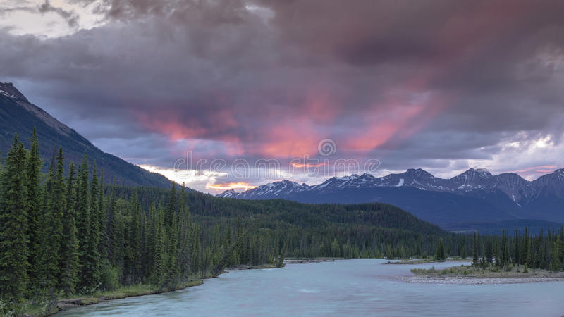 Athabasca River sunset over Pyramid Mountain royalty free stock image