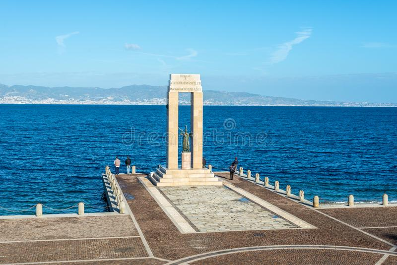 Athena statue in Reggio Calabria, Italy. Reggio Calabria, Italy - October 30, 2017: Athena goddess Statue and Monument to Vittorio Emanuele at Arena dello stock image