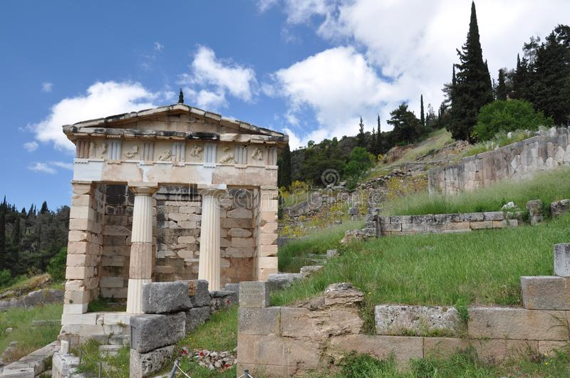 Athenian Treasury in Delphi. The Athenian Treasury at Delphi was constructed by the Athenians to house dedications made by their city and citizens to the stock image