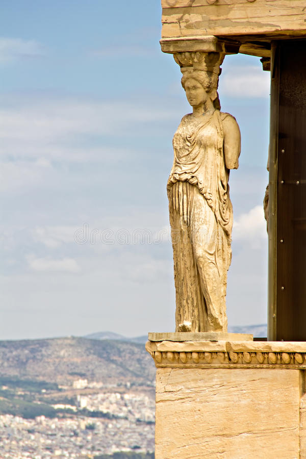 Athens Acropolis, Caryatids Statue. Greece, Athens, Acropolis, Caryatids Statue with Athens city in the background royalty free stock photo