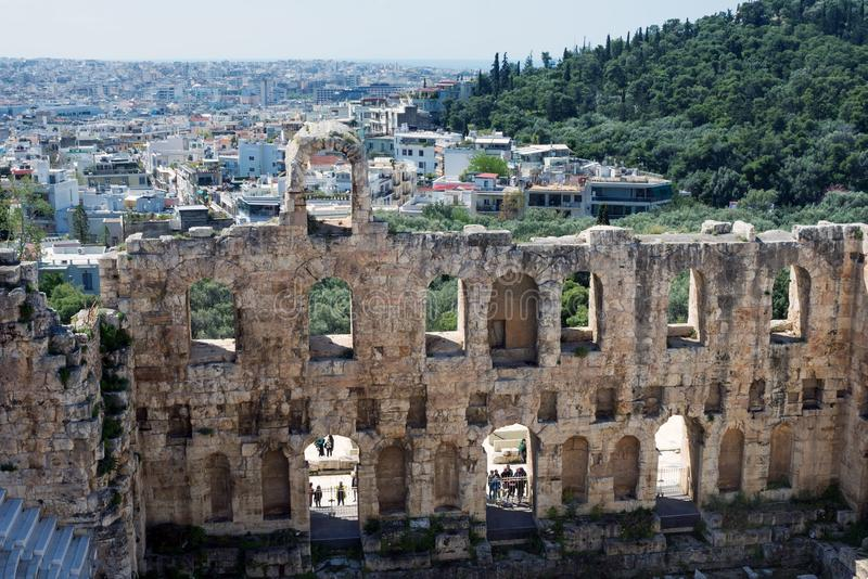 Ancient stone theater with marble steps of the Odeon of Herodes Atticus on the southern slope of the Acropolis. Athens, Greece, April 2019. Ancient stone stock photos