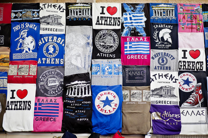 Athens, Greece - April 19, 2015 Tshirts souvenir shop in the capital of Greece at Athens Plaka - T-shirts merchandising with stock photography