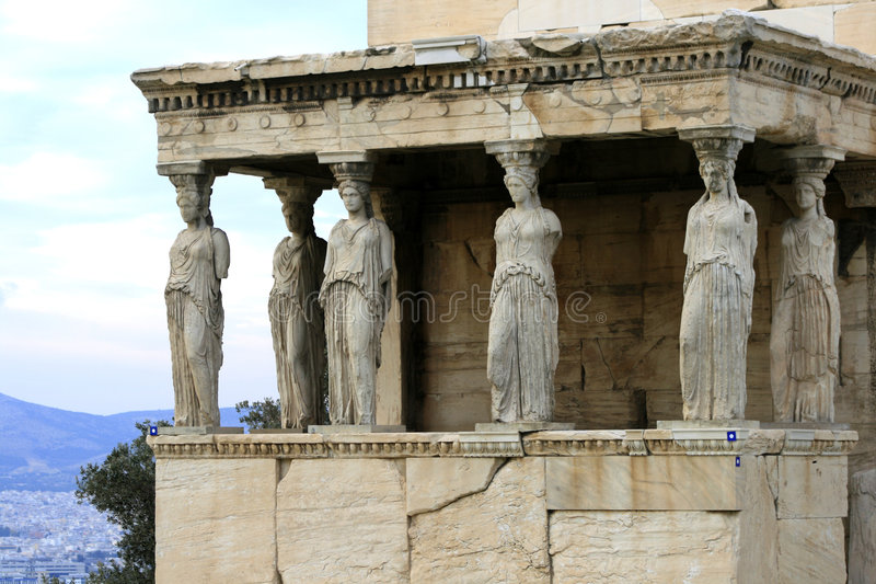 Athens, Greece - Caryatids of the erechteum. Athens, Greece - Caryatids, sculpted female figures, used as columns to hold portion of the roof of the erechtheum stock photography