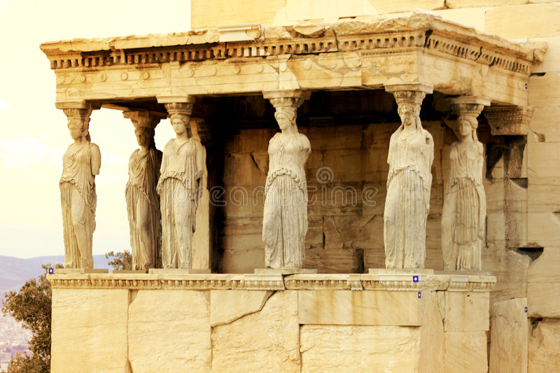 Athens, Greece - Caryatids of the erechteum. Athens, Greece - Caryatids, sculpted female figures, used as columns to hold portion of the roof of the erechtheum royalty free stock photography