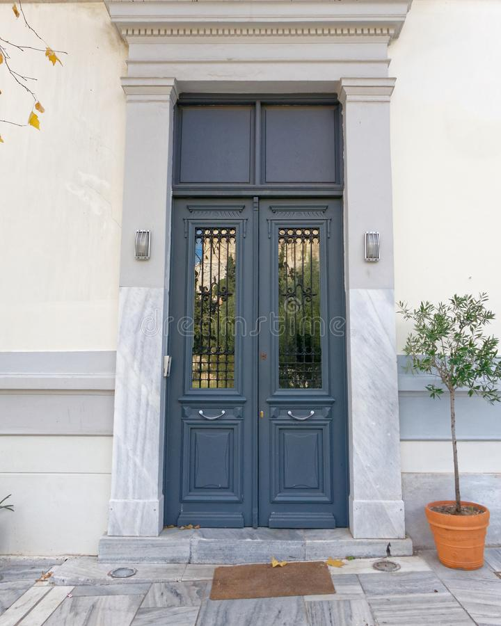 Athens Greece, elegant house door with flowerpot royalty free stock photo