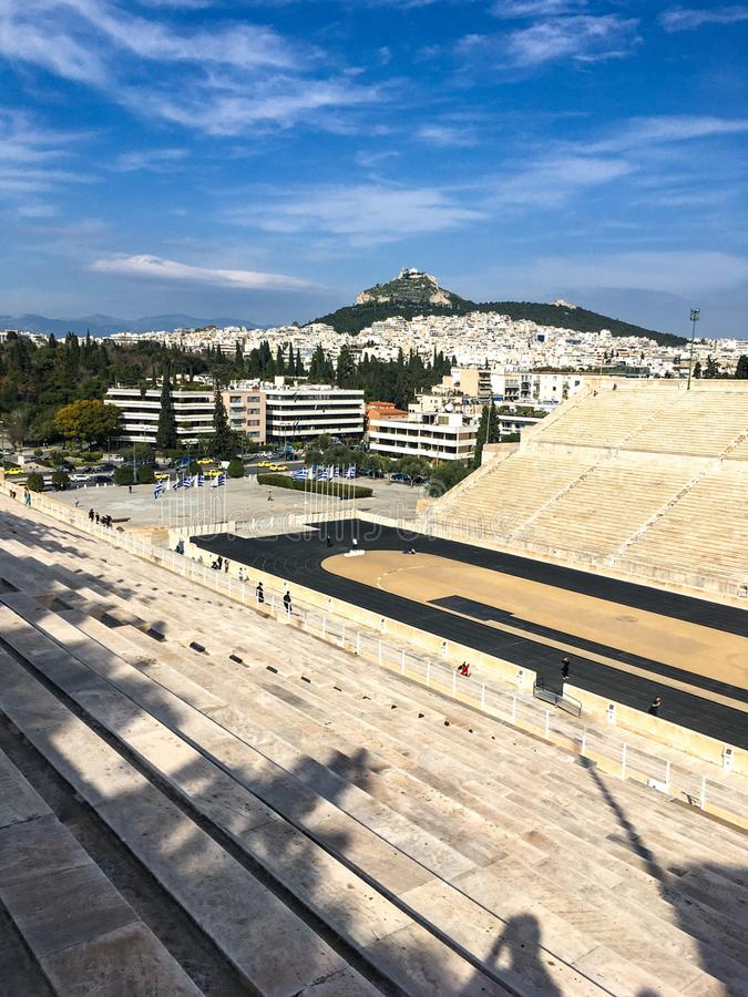 Famous ancient marble Panathenaic Stadium in Athens, Greece built for Olympic games. ATHENS, GREECE - FEBRUARY 5, 2019: Famous ancient marble Panathenaic stock image