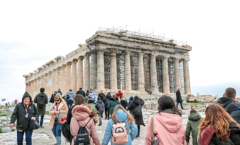 Athens, Greece - February 23, 2019: Tourists visit Parthenon temple at the Acropolis in Athens. View on the side of the western royalty free stock photos