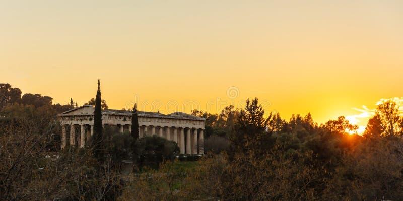 Athens Greece. Hephaestus temple at sunrise time, sun rising against orange color sky. View from Monastiraki area stock photos