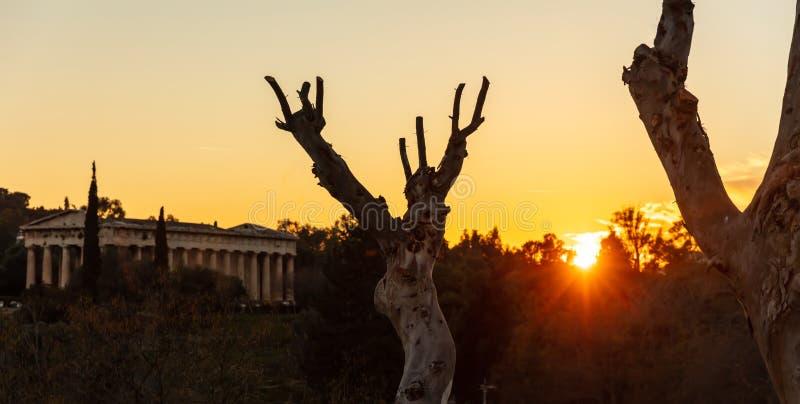 Athens Greece. Hephaestus temple at sunrise time, sun rising against orange color sky. View from Monastiraki area royalty free stock images