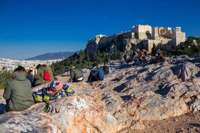 Athens, Greece, January 30 2018: People enjoy the view to the city of Athens from the hill of Areopagus royalty free stock image