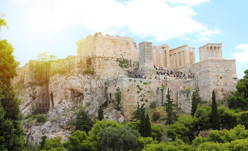 ATHENS, GREECE - JULY 18, 2018: close up view of famous Acropolis with people who visit the Parthenon, Erechtheum, Propylaea and stock images