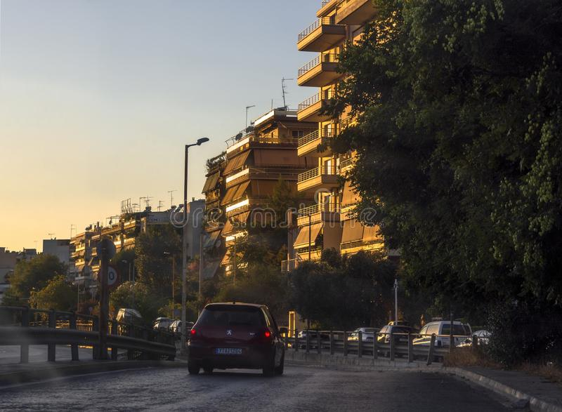 Athens, Greece. July 2019: Greek capital Street with cars and typical Greek architecture at sunset stock photography