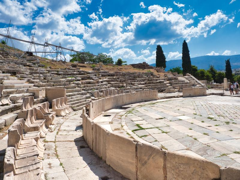 Marble seats in the ruins of Dionysus Theatre in Athens center. Athens, Greece - July 20, 2019 Marble seats at Theatre of Dionysus built at foot of Athenian stock images