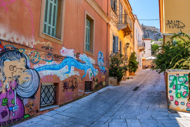 ATHENS, GREECE - JUNE, 2011: Central street with graffiti. ATHENS, GREECE - JUNE, 2011: Beautiful view of street with walls covered in graffiti on sunny day royalty free stock image