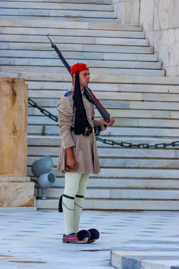 ATHENS, GREECE - JUNE, 2011: Evzone guard. On Synrtagma Square, the central square in the city. Popular tourist attraction stock photo
