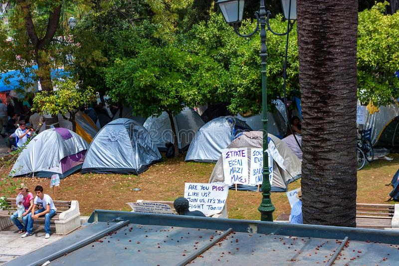 ATHENS, GREECE - JUNE, 2011: People on strike. ATHENS, GREECE - JUNE, 2011: Tents and placards of people on strike royalty free stock photography