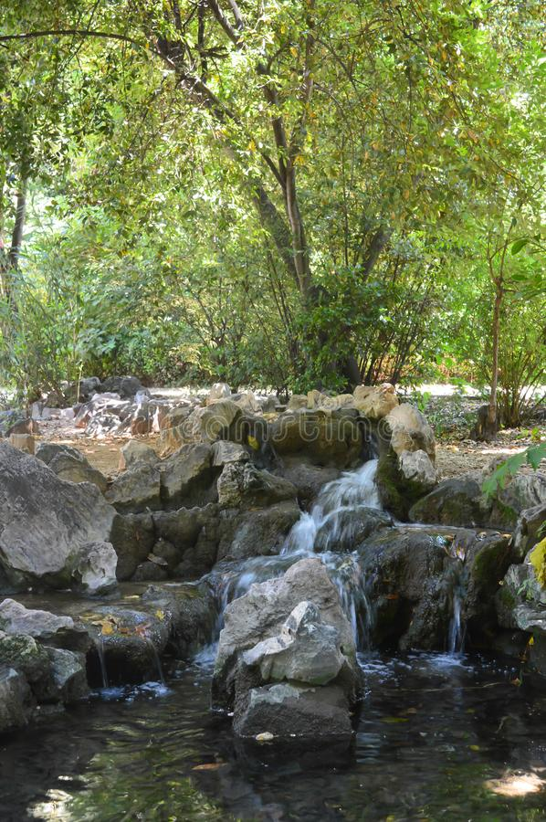 Small Waterfall in National Garden in Athens, Greece on June 23, 2017. ATHENS, GREECE - JUNE 23: Small Waterfall in National Garden in Athens, Greece on June 23 stock photography