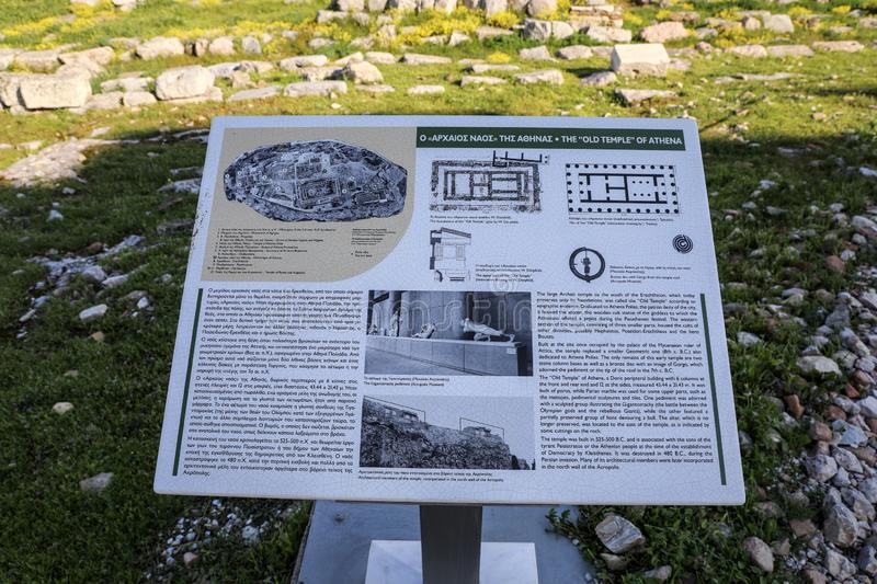 Athens, Greece - March 14, 2017: The information board in front of the Old Temple of Athena on the Acropolis of Athens, Greece royalty free stock photography