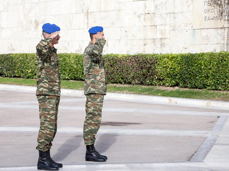 Greek solider saluting the Greek presidential guard, in front of the Greek parliament on Syntagma square. stock photo