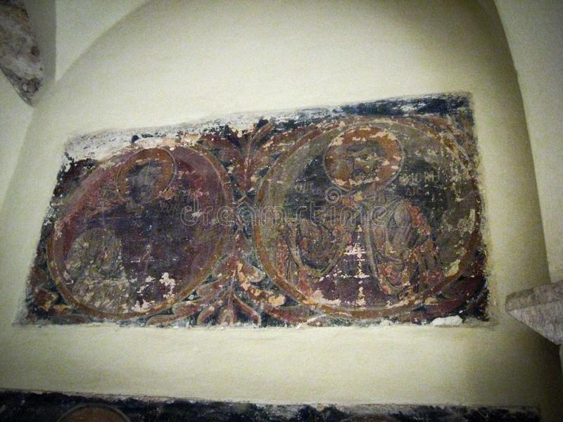 ATHENS, GREECE - OCTOBER 14, 2008: Ancient fresco icons on the wall of an Orthodox church stock image