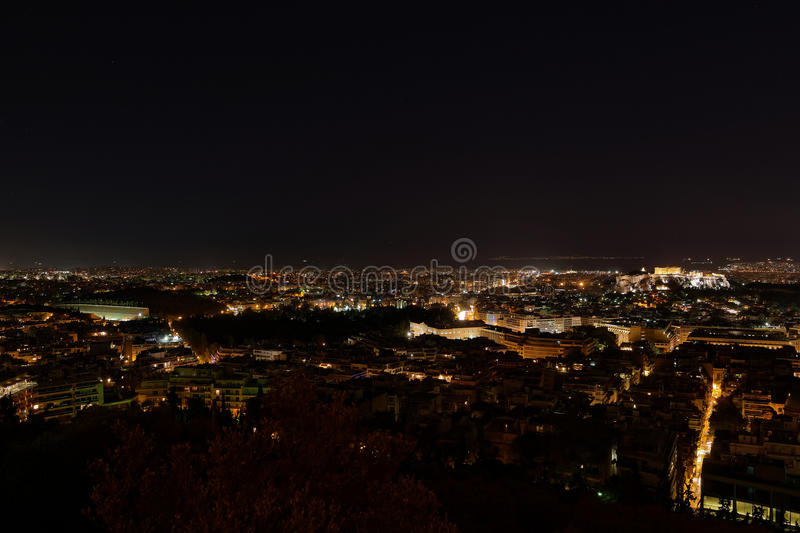 Athens Greece, panoramic night view. Acropolis hill on the right and panathenaikon stadium on the left royalty free stock photography